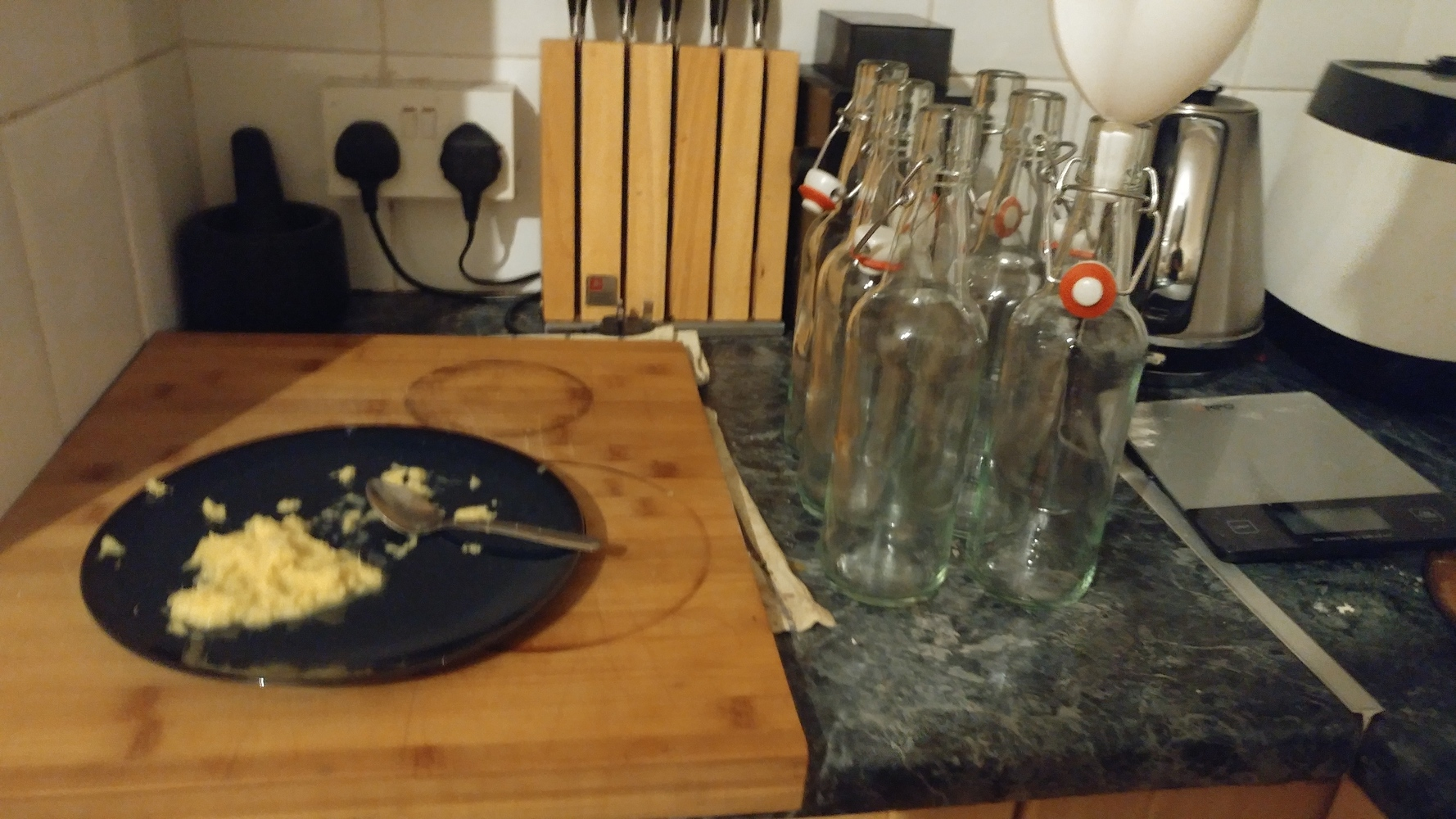 Grated ginger with bottles ready to be filled